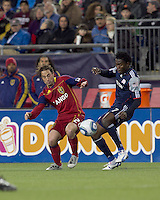 Real Salt Lake midfielder Ned Grabavoy (20) and New England Revolution forward Kenny Mansally (7) battle for the ball. In a Major League Soccer (MLS) match, Real Salt Lake defeated the New England Revolution, 2-0, at Gillette Stadium on April 9, 2011.