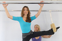Tina Bergen, 31, owner and operator of Bergen Studio, gives her client  Shauna Brittenham, 26, a private Pilates session on Friday, June 13, 2008.