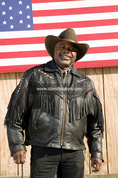 2 December 2006 - New York City, NY - Karl Washington, aka Comboy Wash, a member of the Federation of Black Cowboys, poses for the photographer at the Cedar Lanes stables in the borough of Queens in New York City, USA, 2 December 2006. The Federation gathers black men and women who recreate the heritage of black cowboys, teach kids to ride and put on 'rodeo showdeos'.
