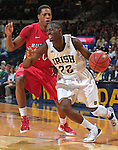 Guard Jerian Grant (22) dribbles around Rutgers Scarlet Knights guard Mike Poole (10).
