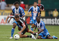 WASHINGTON, D.C. - AUGUST 19, 2012:  Nick DeLeon (18) of DC United loses his shorts to a tackle by Michael Lahoud (13) of the Philadelphia Union during an MLS match at RFK Stadium, in Washington DC, on August 19. The game ended in a 1-1 tie.