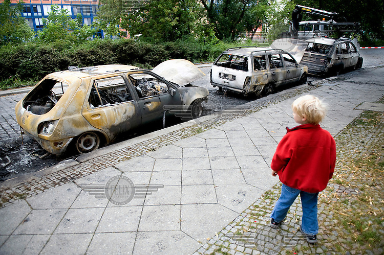 Burned out cars in Berlin Mitte. The cause of the fire is not immediately known, but investigating police officers said an arson attack is likely as a series of over several hundred attacks happened in Berlin already since 2009.