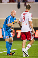New York Red Bulls goalkeeper Bill Gaudette (88) talks with Jan Gunnar Solli (8). The New York Red Bulls  defeated the Portland Timbers 3-2 during a Major League Soccer (MLS) match at Red Bull Arena in Harrison, NJ, on August 19, 2012.