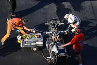 Jun 17, 2016; Bristol, TN, USA; Crew members with NHRA top fuel Harley motorcycle rider Rich Vreeland during qualifying for the Thunder Valley Nationals at Bristol Dragway. Mandatory Credit: Mark J. Rebilas-USA TODAY Sports