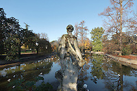Statue overlooking a pond in the Jardin Public de Bordeaux, a park created in 1746 by Tourny, Bordeaux, Aquitaine, France. The park is listed as a historic monument and contains a Natural History Museum, a botanical garden and the famous Guignol Guerin puppet theatre. Picture by Manuel Cohen