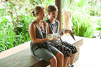 The girls with a baby salt-water crocodile.<br /> Bali.