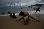 Vietnamese children play on the beach in Nha Trang, Vietnam.