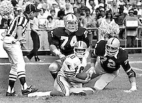 Atlanta Falcons QB Stever Bartkowski is sacked by Raiders Dave Pear and John Matuszak. (1979 photo/Ron Riesterer)