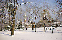Winter View of Students crossing the UVM Campus Green with Ira Allen Chapel and Billings Library in the background. UVM Winter Campus
