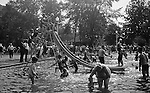 """South Park PA: Stewart children having fun at the South Park Swimming pool - 1929. The philosophy of recreation in the '20s and '30s was different than it is today. The differences between the haves and the have-nots of society was understood differently, and the county parks were called """"the people's country clubs,"""" bringing to poorer people the same recreation that the wealthy paid for at private clubs: golf, tennis, swimming, picnicking. The parks offered common folk the chance to escape to rural campgrounds, day camps, and """"retreats."""" Certain modern recreational concepts had not yet arrived: people didn't """"swim,"""" they """"bathed""""; hence, a large South Park pool was only four feet deep at its deepest point."""