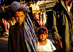 An unidentified young Taliban boy with his sister and father on July 24, 1996 in Herat, Afghanistan. The Taliban took over most of Afghanistan in 1996 and have forced the people to live under strict muslim Sharia law..(Photo: Per-Anders Pettersson/Liaison Agency)