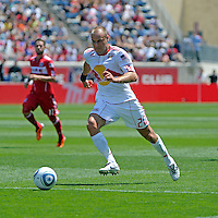 New York midfielder Joel Lindpere (20) dribbles toward the Chicago goal.  The Chicago Fire tied the New York Red Bulls 1-1 at Toyota Park in Bridgeview, IL on June 26, 2011.
