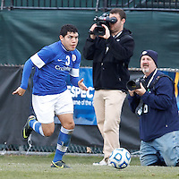 Creighton University defender Benito Amaral (3) dribbles down the wing..NCAA Tournament. Creighton University (blue) defeated University of Connecticut (white), 1-0, at Morrone Stadium at University of Connecticut on December 2, 2012.