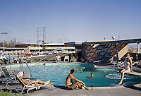 People relaxing by the Empeys Desert Villa pool in Las Vegas. 1958 retro photograph.