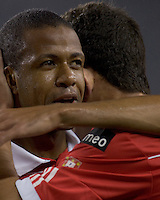 SL Benfica defender Sidnei (27) celebrates his goal. SL Benfica  defeated New England Revolution, 4-0, at Gillette Stadium on May 19, 2010.