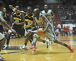 "Ole Miss guard Chris Warren (12)  dribbles against Southern Mississippi guard R.L. Horton (15) at C.M. ""Tad"" Smith Coliseum in Oxford, Miss. on Saturday, December 4, 2010."