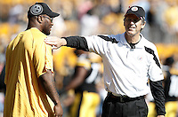 PITTSBURGH, PA - OCTOBER 09:  James Harrison #92 of the Pittsburgh Steelers talks with defensive coordinator Dick LeBeau while watching warm ups prior to the game against the Tennessee Titans on October 9, 2011 at Heinz Field in Pittsburgh, Pennsylvania.  (Photo by Jared Wickerham/Getty Images)