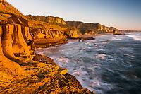 Sunset over limestone cliffs in Punakaiki, Paparoa National Park, West Coast, New Zealand, NZ
