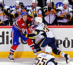 14 December 2009: Montreal Canadiens' center Scott Gomez (91) is checked by Buffalo Sabres right wing forward Patrick Kaleta (36) in the third period at the Bell Centre in Montreal, Quebec, Canada. The Sabres defeated the Canadiens 4-3. Mandatory Credit: Ed Wolfstein Photo