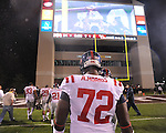 Ole Miss' Aaron Morris (72) walks off the field as Mississippi State players run around with the Golden Egg in Starkville, Miss. on Saturday, November 26, 2011.