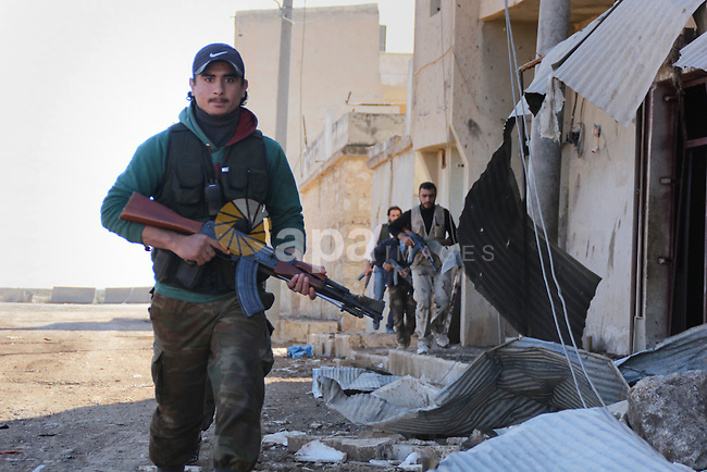 Fighters from the Free Syrian Army patrol the area following clashes with the pro-regime forces in the northern Syrian city of Aleppo, on November 14, 2015. Parties to Syrian peace talks agreed on Saturday to accelerate efforts to end the conflict in Syria by launching negotiations between the government and opposition by January and holding elections within 18 months, U.S. Secretary of State John Kerry said. Photo by Ameer al-Halbi