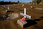 Over 300 plain crosses mark the graves of unidentified border crossers who died during the passage into the United states in Holtville, CA on Thursday, April 13, 2006.<br />