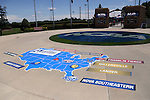 28 May 2016: A map on the sidewalk leading into the stadium shows the location of the eight schools. The Nova Southeastern University Sharks played the Franklin Pierce University Ravens in Game 3 of the 2016 NCAA Division II College World Series  at Coleman Field at the USA Baseball National Training Complex in Cary, North Carolina. Nova Southeastern won the game 4-3 in twelve innings.