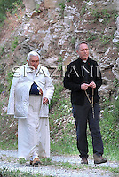 Pope Benedict XVI  Monsignor Georg Gaenswein private secretary,takes a walk in the woods by his alpine chalet in Les Combes, northern Italy, Tuesday, July 28, 2009.