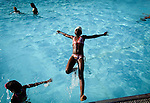 Aichata Gakou falls into Lasker Pool in Central Park on a hot summer day in New York City.