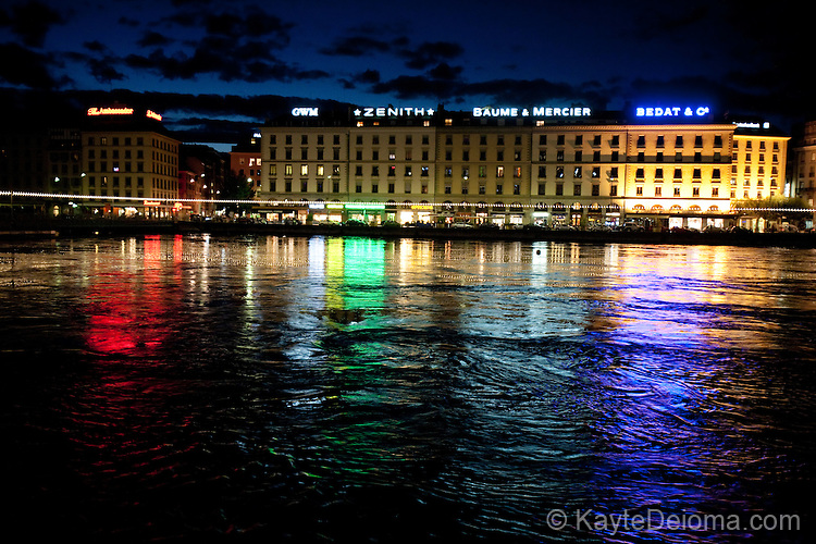 Colored lights from the Geneva Carnival reflected in Lake Geneva, Geneva, Switzerland