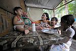 A family eats in a Mindanao village that has declared itself a space for peace, a village where residents have told both the Moro Islamic Liberation Front and the Philippine military to desist from activity within the community. Residents also studied peacebuilding and conflict resolution,  and have made special efforts to increase interfaith dialogue and harmony.