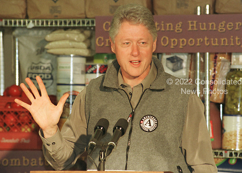 "United States President Bill Clinton speaks at the D.C. Central Kitchen in Washington, D.C. on December 22, 1999 after working as a volunteer preparing food for the homeless.  In his remarks, the President denounced Americans ""apalling"" habit of throwing out 96 billion pounds of food per year..Credit: Ron Sachs / CNP"