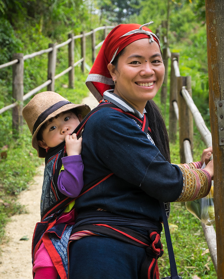 SAPA, VIETNAM - CIRCA SEPTEMBER 2014:  Young woman from the Red Dao minority and her daughter in Ta Phin Village near Sapa, north Vietnam.
