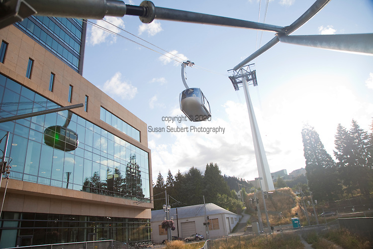 Portland's Aerial Tram cabins travel 3,300 linear feet between the South Waterfront terminal and the upper terminal at the Kohler Pavilion on OHSU's main campus.  Traveling at 22 miles per hour, the Tram cabins rise 500 feet for the three-minute trip over i-5, the Lair Hill neighborhood and the Southwest terwiliger Parkway offering the public stunning views of downtown Portland and the Willamette River.  Round trip tickets cost $4USD.