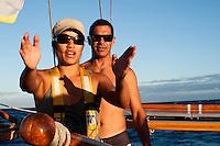 Crew members, Tricia Dang (left) and Kamaki Worthington (right) aboard Polynesian voyaging canoe, Hokule'a; training sail for Worldwide Voyage 2013 _ Augtust 9, 2012 _ Honolulu, Hawaii