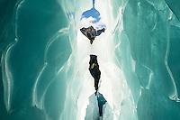 Turquoise ice tunnel, cave on Franz Josef Glacier, Westland Tai Poutini National Park, West Coast, UNESCO World Heritage Area, South Westland, New Zealand, NZ