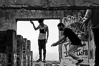Colombian parkour athletes jump inside a ruined house during a free running training session of Plus Parkour team in Bogotá, Colombia, 21 February 2016. Parkour, originally developed in France during the late 1980s from military training, is a physical activity, focused on the art of movement and overcoming obstacles in a strictly urban environment. Practitioners of parkour employ running, climbing, jumping, rolling and other movements to pass through any urban area the most efficient way possible.