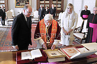 Pope Benedict XVI receives  Prince Albert II of Monaco and his wife Princess Charlene  at the end of a private audience in his private library at the Vatican on January 12, 2013..