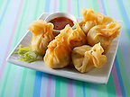 Traditional chinese dim sum with a chilli dipping sauce
