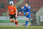 St Johnstone v Dundee United....22.02.11 .Jody Morris passes the ball on the poor surface.Picture by Graeme Hart..Copyright Perthshire Picture Agency.Tel: 01738 623350  Mobile: 07990 594431