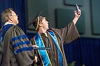 May 17, 2015; A Mendoza College of Business graduate takes a selfie with Dean Roger Huang. (Photo by Matt Cashore/University of Notre Dame)