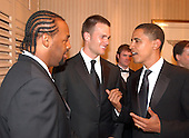 Washington, D.C. - April 30, 2005 -- United States Senator Barack Obama (Democrat of Illinois), right, speaks with Philadelphia Eagles quarterback Donovan McNabb, left, and New England Patriots quarterback Tom Brady, center, at the 2005 White House Correspondents Dinner at the Washington Hilton Hotel in Washington, D.C. on April 30, 2005..Credit: Ron Sachs / CNP<br />