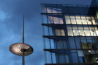 Triangular glass building with spire seen from below, More London Place, Greater London, UK. Picture by Manuel Cohen