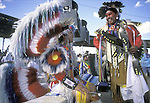 "Native American dancers talking before competition @ pow wow wearing hand made regalia for dance contests, Window Rock Fair and Pow Wow, AZ  ....A pow-wow (also powwow or pow wow or pau wau) is a gathering of North America's Native people. The word derives from the Narragansett word powwaw, meaning ""spiritual leader""."