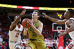 18 February 2017: Notre Dame's Steve Vasturia (32) splits NC State's Torin Dorn (2) and Dennis Smith, Jr. (right). The North Carolina State University Wolfpack hosted the University of Notre Dame Fighting Irish at the PNC Arena in Raleigh, North Carolina in a 2016-17 Division I Men's Basketball game. Notre Dame won the game 81-72.