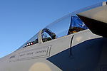 An F-15 Eagle cockpit with American Flag on the dashboard.