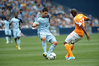 Claudio Bieler (16) forward Sporting KC , Oscar Boniek Garcia (27) midfield Houston Dynamo..Sporting Kansas City and Houston Dynamo played to a 1-1 tie at Sporting Park, Kansas City, Kansas.