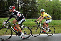David Zabriskie (left), of Team CSC, and race leader Floyd Landis, of Phonak Hearing Systems, rides in the peloton during Stage 5 of the Ford Tour de Georgia on Saturday, April 22, 2006. Tom Danielson, of the Discovery Channel Pro Cycling Team, won the 94.5-mile (152.1-km) stage from Blairsville to the top of Brasstown Bald, the highest point in the state. Landis finished second and retained the race lead, while Zabriskie finished 13th.<br />