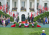 United States President Barack Obama and First Lady Michelle Obama welcome President XI Jinping and Madame Peng Liyuan of China during an official State Arrival ceremony on the South Lawn of the White House in Washington, DC on Friday, September 25, 2015.<br /> Credit: Ron Sachs / CNP