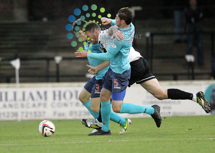 Ayrs Kevin Kyle getting the squeez from the Pars defence of Alex Whittle and Calum Morris. 4 th round of the William Hill Scottish Cup the game between Ayr United V Dunfermline played at Somerset Park Picture by Alistair Mulhearn / Universal News and Sport (Scotland). All pictures must be credited to www.universalnewsandsport.com. (Office) 0844 884 51 22 30/11/2013